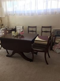 Dining room table with six chairs and table pads