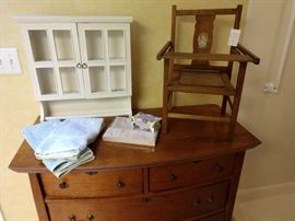 One of two wooden dressers without mirror.