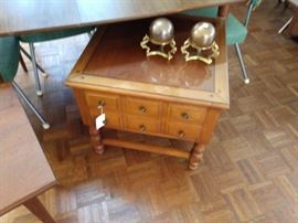 Classic end table with glass top.