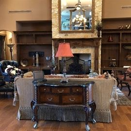 Console table, lamps, black leather chairs