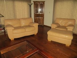 Leather living room furniture, corner cabinet, end tables and lamps.