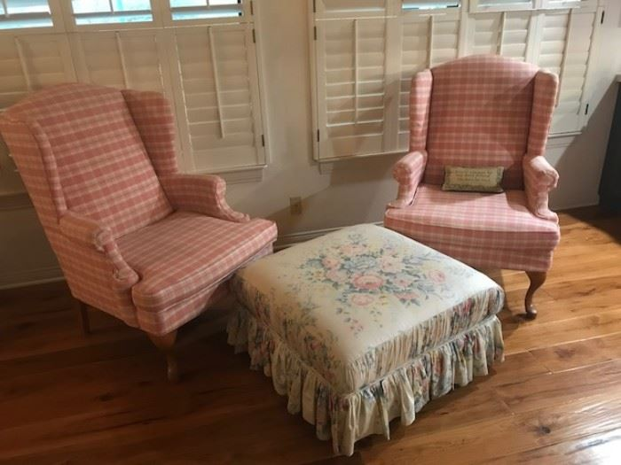 pair of pink wing back chairs
