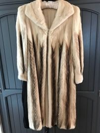•	Large selection of vintage clothing from the 1950's-1980's. Lots of silk and beaded cashmere. •	sweaters! Silk Kimonos and London Fog Cashmere coats.