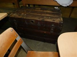 several antique trunks