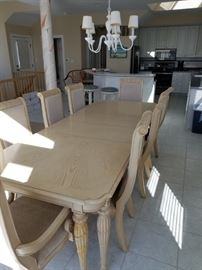 Dining table and chairs made by Kemp Industries