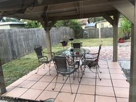 Round glass patio table w/ wicker seat and back and metal base and frames