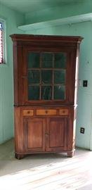 Antique corner cabinet.