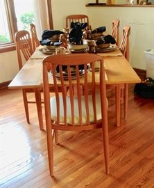 Teak Dining Table with 8 Chairs, in excellent condition.  Comes with Table Pads