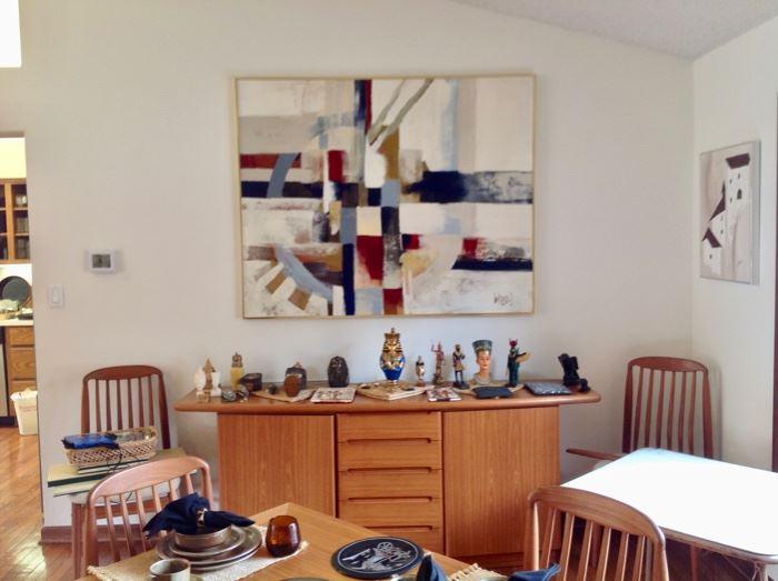 Teak Buffet that matches the Teak Dining Table.  Art Work by Artist Lee Reynolds
