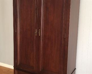 Cherry armoire, brass hardware, 2 drawers and hanging rod assembly inside.  Dimensions: 45 x 22 x76.