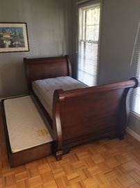 Mahogany twin sleigh daybed with trundle.  Euro-Top twin mattress and trundle mattress included.  Bedding available.  Dimensions 98 x 45 x 41.