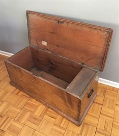 Interior showing separate box for small items and note.