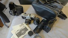 Canon FTB – includes 35mm , 50mm, 100 – 200mm Lenses, Flash Speed lite 13D Flash ring, Manuals
