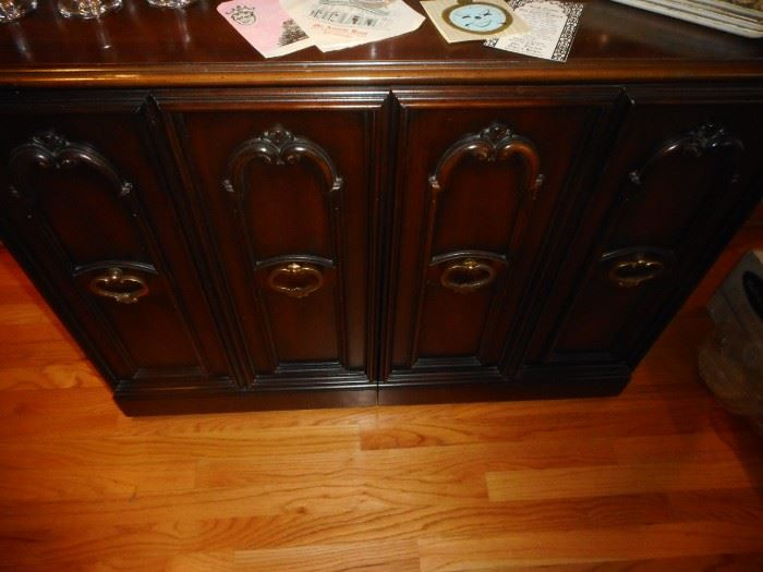 Vintage Mahogany Cabinet. Opens to Expandable Dining Table, Leaves. Pushed back..Cabinet.