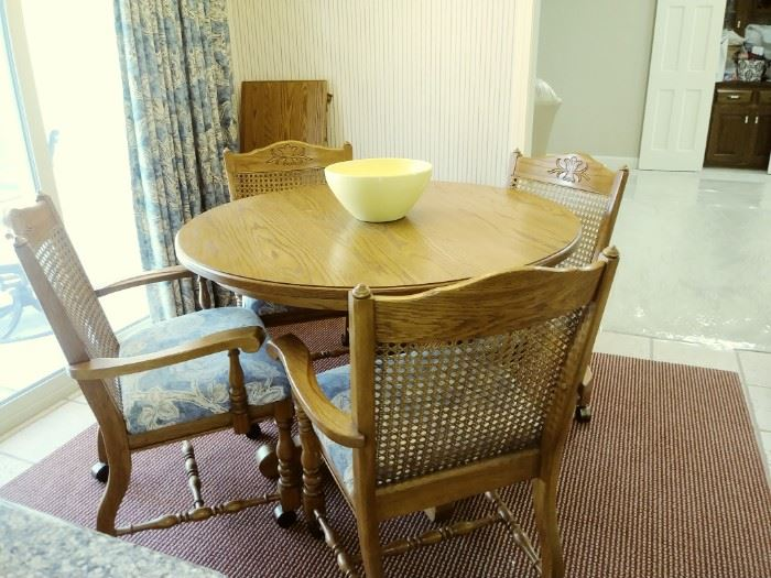Solid oak table and 4 rolling chairs