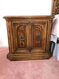 Wooden bedside table with doors and shelves inside https://ctbids.com/#!/description/share/100179