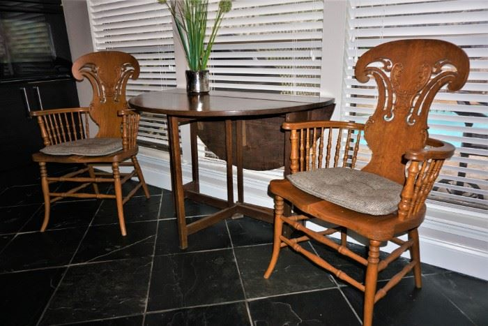 Drop leaf table and oak chairs