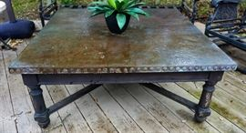 Teak table with hammered copper top