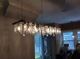 Artist made iron pipe chandelier with antique crystals $1000