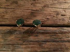 Emerald earrings set in gold. $250
