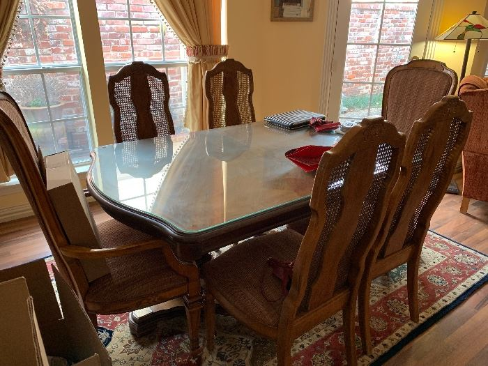 dining table with 6 chairs and 2 leafs.  There is a glass top for table when leafs are not used