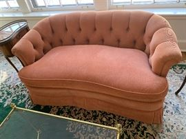 Comfy coral colored plush loveseat
