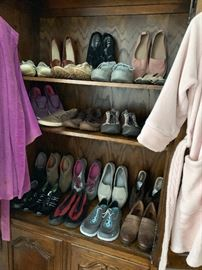 Many pairs of ladies designer shoes and boots, gently used.