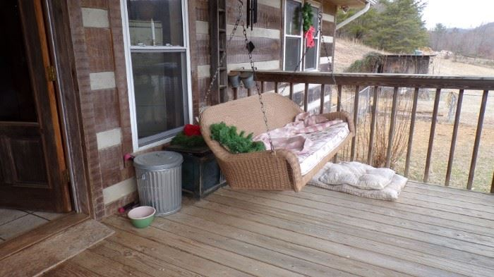 Swing,  wood Box behind it, and Dog Matts and aluminum Can