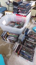 4 shoe totes, the big white storage tote, the big box next to the white one that's full and stacked on top and there's even more DVD's.  A big assortment of movies.  We also have CD's (but not this many)