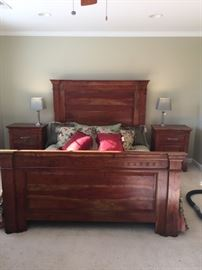 Gorgeous Queen size mesquite wood sleigh bed with hand carved detail.