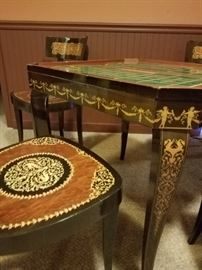 """Product Description and Specifications: ·         This table features a BEAUTIFUL TOP with a MULTI-COLOR FLORAL INLAY. ·         The table can be set up with Inlaid Side featuring Swirls or Turned over to Feature a Backgammon Table. ·         You can then Remove the Top and reveal green felt for Card Playing or Flip it over to reveal a Chess / Checker Board. ·         Remove this piece and a Roulette Table is Revealed, Slide open the sides and you will then find the Roulette Wheel. (10"""" Roulette Wheel). ·         Table is in excellent condition and  (not in box).  ·         The table measures 27.5"""" x 27.5"""" x 28"""" high.  When extended to reveal the roulette wheel it is 41"""" wide."""