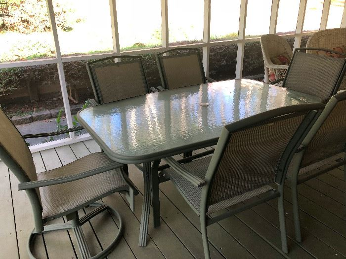 Glass top patio table and 6 chairs, including 2 swivel chairs