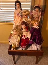 A small audience of antique dolls