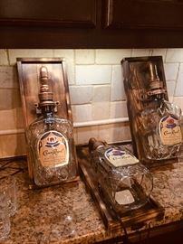 Lighted Crown Royal bottles on wood