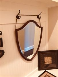 Mirror with hanging chain