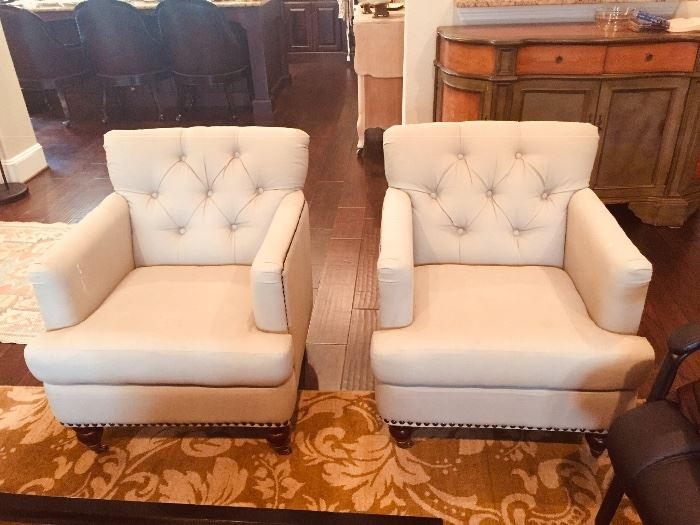 Pair of tufted beige chairs