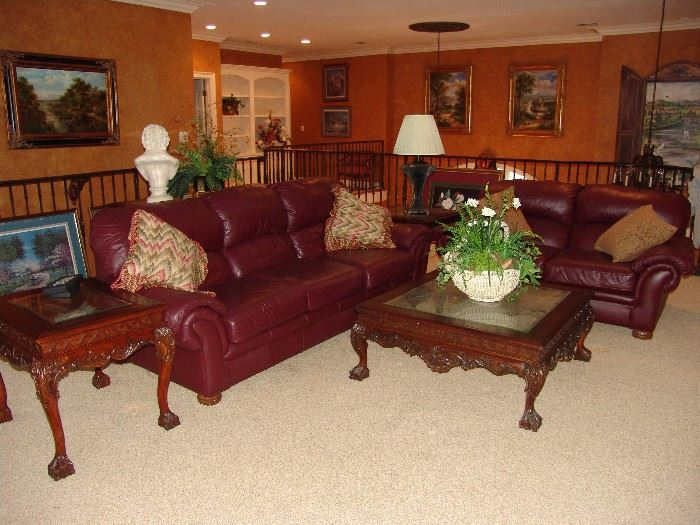 Leather sofa and matching loveseat and mahogany end and coffee tables