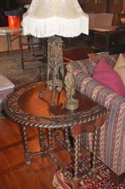 Carved Drop-Leaf Table with Statuary and Lamp