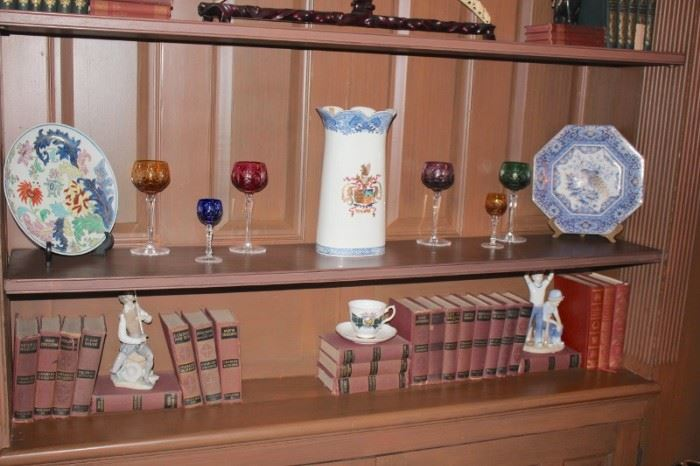 Assorted Statuary, Books, Colorful Stemware and Decorative Plates
