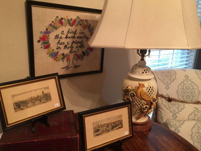 Porcelain lamp, needlepoint artwork, framed prints.