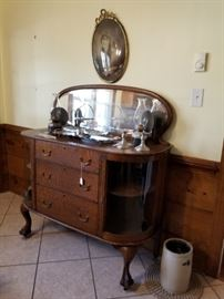 antique chest with mirror and side display areas