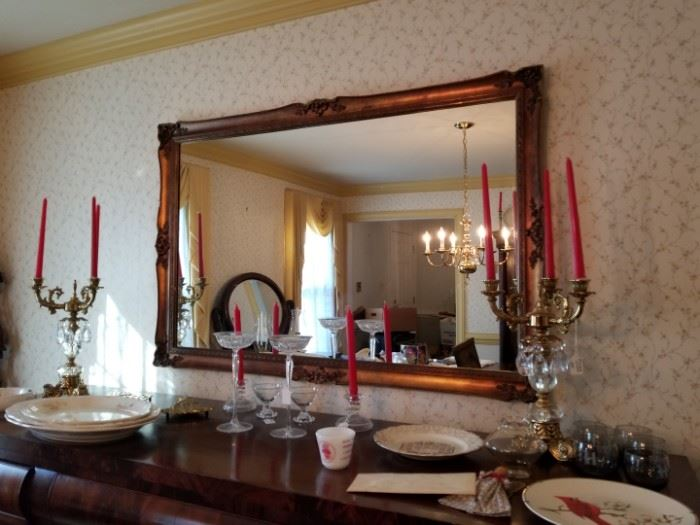 vintage mirror in dining room with candelabras