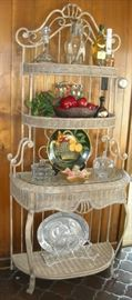 Wonderful wicker and iron tall etegere matches round glass top breakfast table.