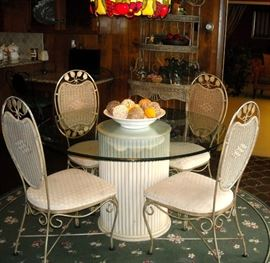 Lakeside breakfasts will taste better while sitting at this lovely round glass top pedestal table and four matching chairs.