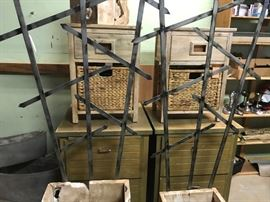 Metal (heavy) garden trellis',  pair of freshly unpacked end tables with basket drawers (think beach house).