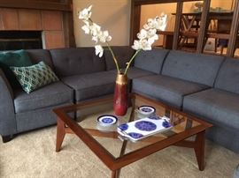 Modern sectional in gray fabric, modern glass top coffee table