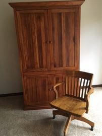 Modern entertainment center; oak swivel office arm chair