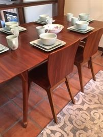Modern laminate table with additional leaf, two chairs and a bench
