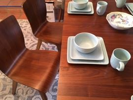 Detail of modern laminate chairs and table; service for 8 in Robin Egg Blue glazed ceramic