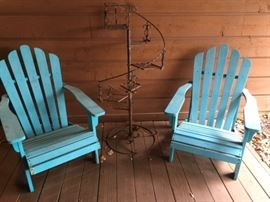 Pair of Adirondack-style arm chairs in blue paint; antique wrought iron tiered plant stand